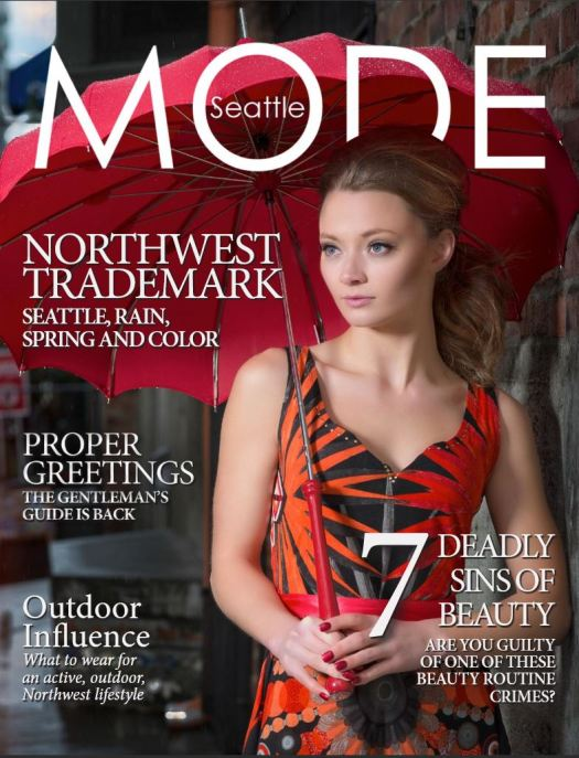Image: MODE April issue cover. Female model holding an umbrella.